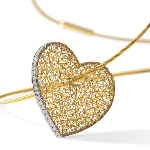 Tom Rucker Jewellery necklace gold heart. Gold and platinum necklace with rare white brilliant-cut diamonds.