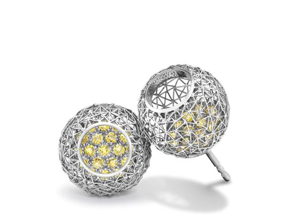 Tom Rucker Jewellery. Platinum 950 earrings with natural fancy yellow diamonds