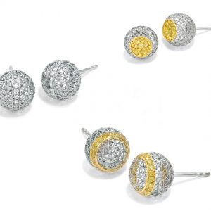 Tom Rucker Jewellery earrings ear studs. Platinum and gold ear stud, earrings with rare white and natural vivid yellow brilliant cut diamonds.